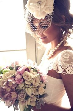 Brides messy updo birdcage veil bridal hair Toni Kami Wedding Hairstyles Wedding hair Lovely wedding photography idea pearls lace