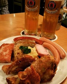 TGIF!! A good way to start my weekend  Beer n pork are always best (read: deadly) combination.... Paulaner platter to share These are poached smoked pork chopdebrecener sausage meatloaf Vienna sausages Nuremberg sausage and crispy pork knuckle served with sauerkraut and mashed potato  #paulaner #platter #share #sausage  #meatloaf #containpork #nonhalal #porkknuckle #maskedpotato #beer #lager #porkchop by eunikeutami #haxenhaus #people #food