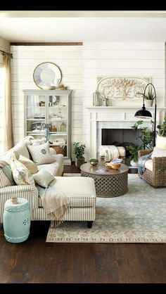 I Love the white shiplap and the rustic medium toned floors and beams above.  I really like the pretty creams, blues and grays. It has a aged, homey, comfortable feel than collectibles would look good in.