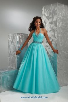 Flirt P4574 Halter Ballgown By Maggie Sottero, ManufacturerFlirt by Maggie SotteroStyle#P4574Colors AvailableFrosty Aqua, Light Purple Royale, SunplosionSizes Available0-28DetailsTulle ballgown featuring ruched bodice, jeweled waistband and necklace-style halter straps, sequins scattered on skirt, and corset back.