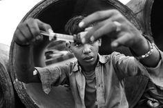 """A 16-year-old boy prepares one of his daily injections. A so-called """"set"""", consisting of an ampule of Buprenorphine (semi-synthetic opioid), an ampule of Diazepam (Valium), an ampule of Avil (an antihistamine,) and two disposable syringes is sold for 50 rupees—a little less than $1. Regular customers of the local pharmacies sometimes even get a discount or an extra strong painkiller tablet for free"""