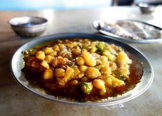 Aloo channa masala - Potato and chickpeas masala - authentic Indian recipe from a street restaurant in Rajasthan, India (source: my personnal food and travel blog / vlog with recipes, authentic video recipes, street food, food and travel documentary, travel info and more. Welcome! :) )