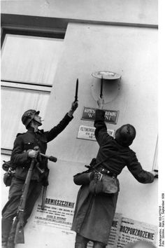 German Wehrmacht soldiers use their bayonets to remove the Polish emblem from the post office in the city of Danzig. When Poland regained its independence after World War I with access to the sea as.