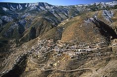 Aerial view of Jerome, AZ former ghost town turned artists colony...hard to imagine how this former mining town was created -- it is very high and fairly dangling from the mountain side!  Visited in 1997 driving up from Scottsdale
