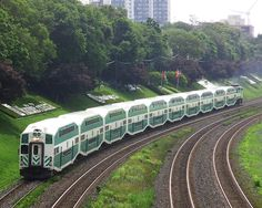 A GO Transit commuter train on the Lakeshore West line in Toronto, Canada, travelling westbound to Burlington. Photograph was taken looking east from the Roncesvalles Avenue pedestrian bridge. Date 3 July 2008 Go Transit, U Bahn Station, Tramway, Commuter Train, Trains, Bonde, Pedestrian Bridge, Downtown Toronto, Light Rail