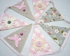 Pretty handmade bunting made to order - this one was for a baby girl's bedroom. Made using Tilda fabrics in greys and soft pinks and decorated with butterflies, flowers and buttons.  www.facebook.com/iloveprettythings.co.uk