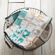 """DIY at Your Doorstep: """"Oh, Baby"""" Quilt-The perfect gift for a newborn, this handcrafted heirloom-to-be combines time-honored techniques with fresh, graphic fabrics."""