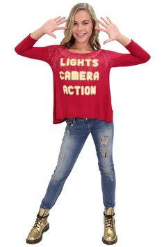 The Maddie & Mackenzie shirt collection contains versatile pieces with soft fabrics and positive inspirational messages. This great shirt has fun thumbholes and is perfect for the girl destined to see her name in lights!