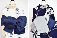 深い紺色の地に、ふわりと浮かぶ桜の花と矢羽根模様が織り出された半幅帯です。