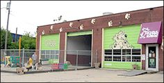 This is the perfect example of how I would use an old building with garage doors!