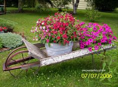 My First and Favorite Junk Garden Purchase About 15 years ago I purchased my first and favorite junk garden collectible, my wheelbarrow. I paid $15 for it at a garag...