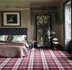 Astounding!  Not a particular fan of plaid, yet look at how this rug pulls the whole room together - I'm shocked at how much I like this!