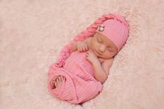newborn baby girl sleeping on a soft pink blanket, unique fine art baby portraits by Olga Klofac Professional Baby & Child Photographer Charlestown Mayo  www.mayophotographer.ie