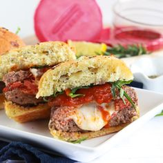Think you've got the ultimate game-day treat? No way! These pizza-stuffed burgers are the greatest mouthful of food ever, and you won't believe how easy they are to make! An Italian spiced burger mix is stuffed with fresh mozzarella and chopped pepperoni, then browned in butter and baked to perfection. If you like the heat, add red pepper flakes. If you don't, feel free to leave them out!