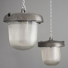 Pair of Steel and prismatic glass industrial lights from the Eastern Bloc
