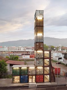 World's Tallest Shipping Container commercial building 17 containers comprise the 4 stories of Freitag's new Zurich store, situated near the transit bridge with roof-top views of the city. Who knew a simple cycling solution could turn into a high-style recycling empire?But in scaling up, Freitag's never compromised their commitment to material reuse and local production (in Zurich).http://inhabitat.com/freitag-shop-is-worlds-tallest-shipping-container-structure/