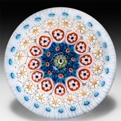 Drew Ebelhare 1997 close concentric in a stave basket miniature glass paperweight. by Drew Ebelhare & Sue Fox