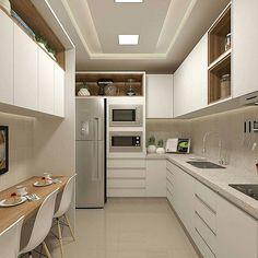 Inspiração para cozinha clean, no estilo corredor, com muitos armários e espaço para refeições rápidas. ❤❤ By Lorena Leão