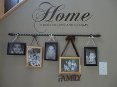 Curtain Rod and some ribbon to hang the pictures up. Easy and adorable!