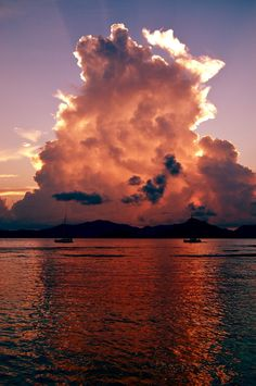 Awesome cloud in shafes of red and orange over the sea!!! Bebe'!!! Love the rosey orangey red glow reflected by the sun behind the clouds onto the sea water below!!!