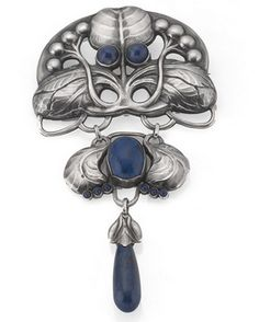 Evald Nielsen (attrib), Skonvirke silver and lapis lazuli brooch. I am attributing this to Evald Nielsen as it is very closely similar to a pendant brooch that has the SJ mark for S. L. Jacobsen, who made many of Nielsen's designs and which was attributed to Nielsen by Kitty's Jewellery.