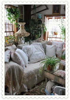 a livingroom with wonderful appeal.... leaded glass windows... plants and comfy furnishing....