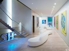 The travertine-tiled entrance gallery of Donny Deutsch's New York townhouse, designed by Tony Ingrao and Randy Kemper, is anchored by bespoke Ingrao Inc. sofas, both upholstered in a Perennials bouclé.