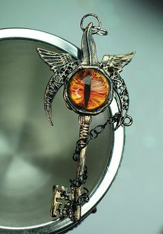 Chained Eye of the Inner Demon Key Necklace by KeypersCove on Etsy ITS SMAUG!! OR SAURON!!! GUYS!!!