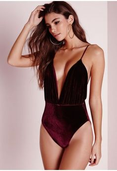 Oh La Laa.. Get some sex appeal, be brave and put on this extreme plunge body suit! The luxurious velvet will give you the confidence to take centre stage and dazzle your 'wits'. This burgundy pink body features a low back and thin adjustab...