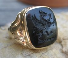 Regal & Mystical Antique Gryphon Onyx Intaglio Ring 14k. The Gryphon is a legendary creature with the head, wings & talons of an Eagle & the body of a Lion that represents Bravery, Wisdom, Nobility, Gentleness, & Justice. Bold & detailed this Ring is a Statement Piece & One's own Personal Talisman! Circa 1700 Jewelry Line.
