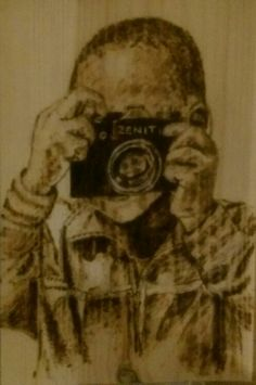 "Pyrography on pine: ""Boy with camera"""