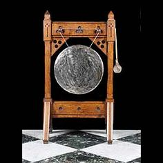 Victorian oak dinner gong and stand in the Pugin style, with bronze gong, the framed stamped 1861.