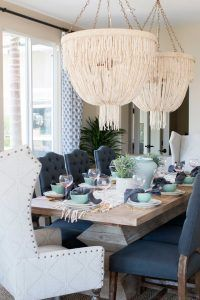 Dining room lighting. Dining room lighting. Made Goods Carmen Chandelier. Coco beads are loosely draped and gathered in this glamorous chandelier. Accented with sparkly clear beads. #DiningRoom #Lighting #Carmen #Chandelier #MadeGoods Blackband Design