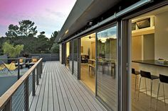 Could anything be more romantic than floor-to-ceiling glass from one end of the house to the other?