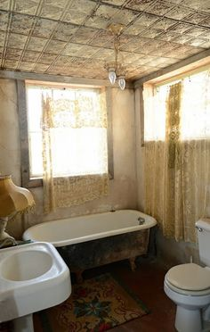 A rustic bathroom with hints of glamor.