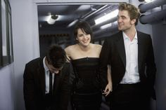 """Tink {Robsessed blog} says: """"I loved this pic a long time ago and the backstage Kimmel pic is still my fave of the trio. 2009 was a good height for the Twilight years and for me, this pic is a good representation of the booming success. Rob looks so dashing, i can't even handle it. tall, handsome, gentlemanly, charming, confident. SIGH."""""""