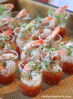 Little shrimp cocktails - no recipe on the drill down - Only this serving suggestion in the little shot cups - makes it fast for the pick ups  This would also be good with a wasabi and cream cheese dip at the bottom, too.