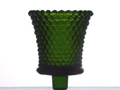 Home Interiors Peg Votive Holder Dark Green Hobnail  Hobnail pattern like raised dots define the appearance of this pretty holder. This holder is a vintage one, and getting harder to find. Color: Dark Green  Brand: Homco / Home Interiors Height: 3.5 inches, including stem Width: 2.875 inches Color: Dark Green Material: Glass