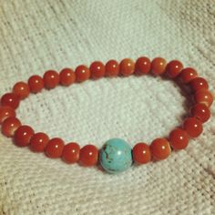 Ceramic red beads and turquoise howlite. From Armstrong Notes available in April. Only $15.00!!