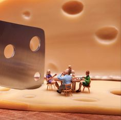 Playful Scenes Feature Miniature Toy People Living in Large Edible Worlds - My Modern Met