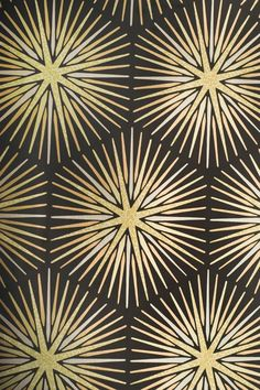 Spark Wallpaper Foiled sunburst design wallpaper in black with metallic gold and bronze cracked glaze sunburst design.
