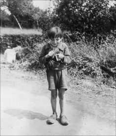 Robert Capa    A French boy eating chocolate given to him by American soldiers, 1944