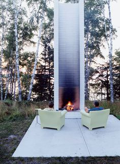 """Philippe Starck's outdoor chairs for Kartell provide cozy fireside seating. These and the sofa version were selected by Salmela. """"They're very much an art form,"""" he says."""