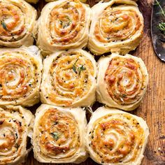 """Herby Everything Cheddar Swirl Buns (recipe) - """"swirled with cheddar cheese, basil pesto, fresh herbs, and a little everything bagel spice too. Fingers Food, Bun Recipe, Half Baked Harvest, Harvest Bread, Snacks Für Party, Strudel, Tapas, The Best, Cooking Recipes"""