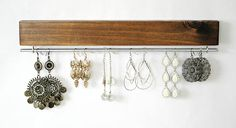 Earring display to feature all your beautiful earrings. Each display is custom to you. Choose your favorite stain and bar/hook finish. Every piece has different wood grain and knots, making them one of a kind piece just for you. This display also goes great with a necklace organizer: