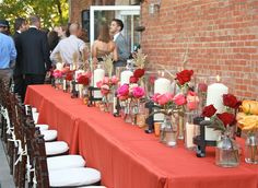 We could put together long tables like this for back porch rehearsal dinner.  Simple centerpieces like the candles/rose petals in my other pin. Lantern lights above.