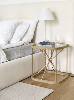 Woodnotes Twiggy table. Woodnotes bed and bed headboard.
