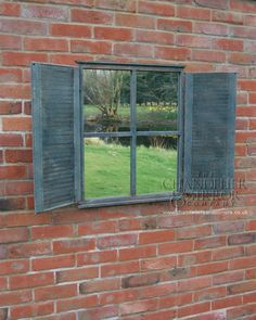 find a pair of old shutters and an old window and replace the glass with a mirror to reflect all the beauty in your garden