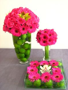 Green lime  pink flower table displays and centerpieces for a bright  cheerful pink  green wedding or party theme.