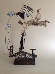 No title yet! Learning to fly in the rain! Paper Mache Sculpture, Sculpture Art, Wire Sculptures, Abstract Sculpture, Wire Wall Art, Sculpture Lessons, Found Object Art, Assemblage Art, Recycled Art